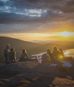 Friends and family on a mountain at dusk